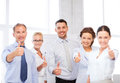 Business team showing thumbs up in office picture of happy Royalty Free Stock Images