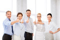 Business team showing thumbs up in office picture of happy Royalty Free Stock Photos
