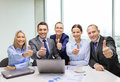 Business team showing thumbs up in office Royalty Free Stock Photo