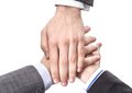 Business team showing unity with hands together closeup of isolated on white background Stock Images