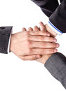 Business team showing unity with hands together closeup of isolated on white background Stock Image