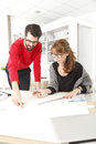 Business team in small architect studio women and businessman working together Royalty Free Stock Image