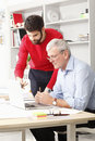 Business team in small architect studio young and senior businessman working together Stock Photos