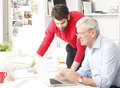Business team in small architect studio young and senior businessman working together Stock Image