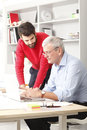 Business team in small architect studio young and senior businessman working together Stock Photo