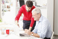 Business team in small architect studio young and senior businessman working together Stock Images