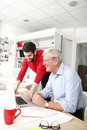 Business team in small architect studio young and senior businessmen working together Stock Photography