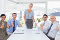 Business team smiling at camera showing thumbs up Royalty Free Stock Photo