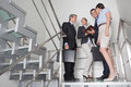 Business team in stairway Stock Images