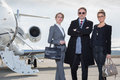 Business team standing in front of private jet Royalty Free Stock Photo