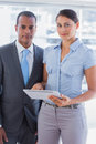 Business team with tablet pc smiling at camera Royalty Free Stock Photo