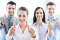 Business team with thumbs up smiling Stock Photo