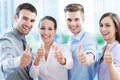 Business team with thumbs up smiling Royalty Free Stock Photos