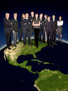 Business team on top of the world Royalty Free Stock Photo