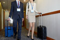 Business team with travel bags at hotel corridor Royalty Free Stock Photo