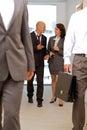 Business team walking thru corridor and talking Royalty Free Stock Images