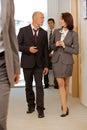 Business team walking thru corridor and talking Royalty Free Stock Photo