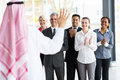 Business team welcoming partner applauding to welcome arabian Royalty Free Stock Photos