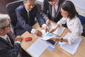 Business team work asian people report analysis meeting discus discussing project planing shot over office working table Royalty Free Stock Images
