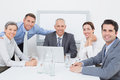 Business team working happily together on laptop in the office Royalty Free Stock Image
