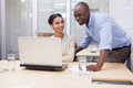 Business team working happily together on laptop Royalty Free Stock Photo