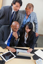 Business team working on laptop together Royalty Free Stock Photo