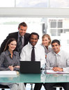 Business team working and smiling at the camera Royalty Free Stock Photo