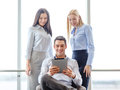 Business team working with tablet pc in office and concept smiling Royalty Free Stock Photography
