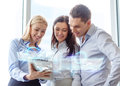 Business team working with tablet pc in office and concept smiling Royalty Free Stock Image