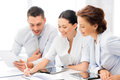 Business team working with tablet pcs friendly having discussion in office Royalty Free Stock Photography
