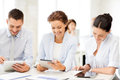 Business team working with tablet pcs in office smiling Royalty Free Stock Images