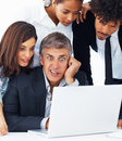 Business team working together on a laptop Stock Photo