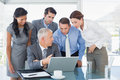 Business team working together on laptop in the office Royalty Free Stock Photography