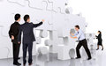 Title: Business teamwork - business men making a puzzle