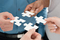 Business teamwork concept closeup businesspeople hand holding jigsaw puzzle Royalty Free Stock Image