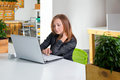 Business technology and green office concept young successful businesswoman with laptop computer at office woman using tablet Stock Images