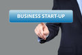 Business, technology and networking concept - businessman pressing business start-up button on virtual screens