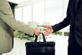 Business transfer. handover of a suitcase partners Royalty Free Stock Photo
