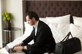 stock image of  Business traveler working on laptop in hotel room