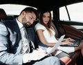 Business trip- Talking on mobile to work of car Royalty Free Stock Photo
