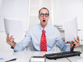 Business weird manager rolling his eyes and holding papers stress frustration Royalty Free Stock Photo
