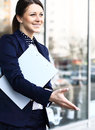 Business woman with arm extended for a handshake Stock Photos