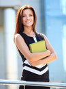 Business woman with arms crossed and smiling casual Stock Photo
