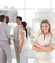 Business woman with associates smiling Stock Photos