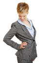 Business woman with back pain holding hand on her Stock Image