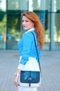 Business woman with bag in front of office building womanwith red hair Stock Photos