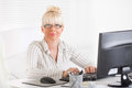 Business woman beautiful mature working in the office Royalty Free Stock Photography