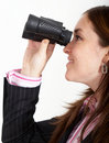 Business woman with binoculars Stock Photo