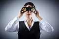 Business woman with binoculars spying on competitors Stock Images
