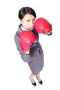 Business woman with boxing gloves in full length Royalty Free Stock Photos